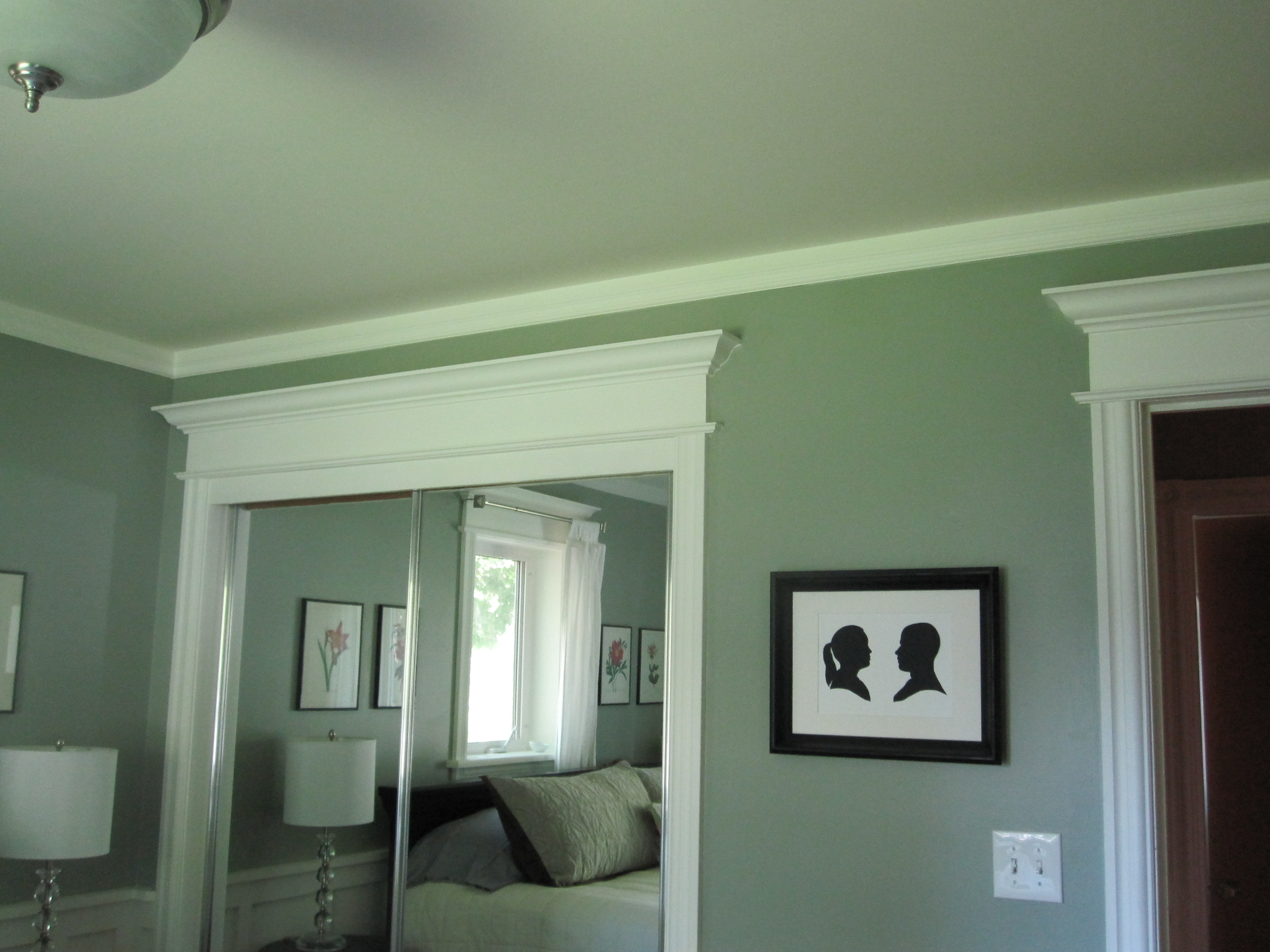 Master bedroom trim over doors for Over door decorative molding