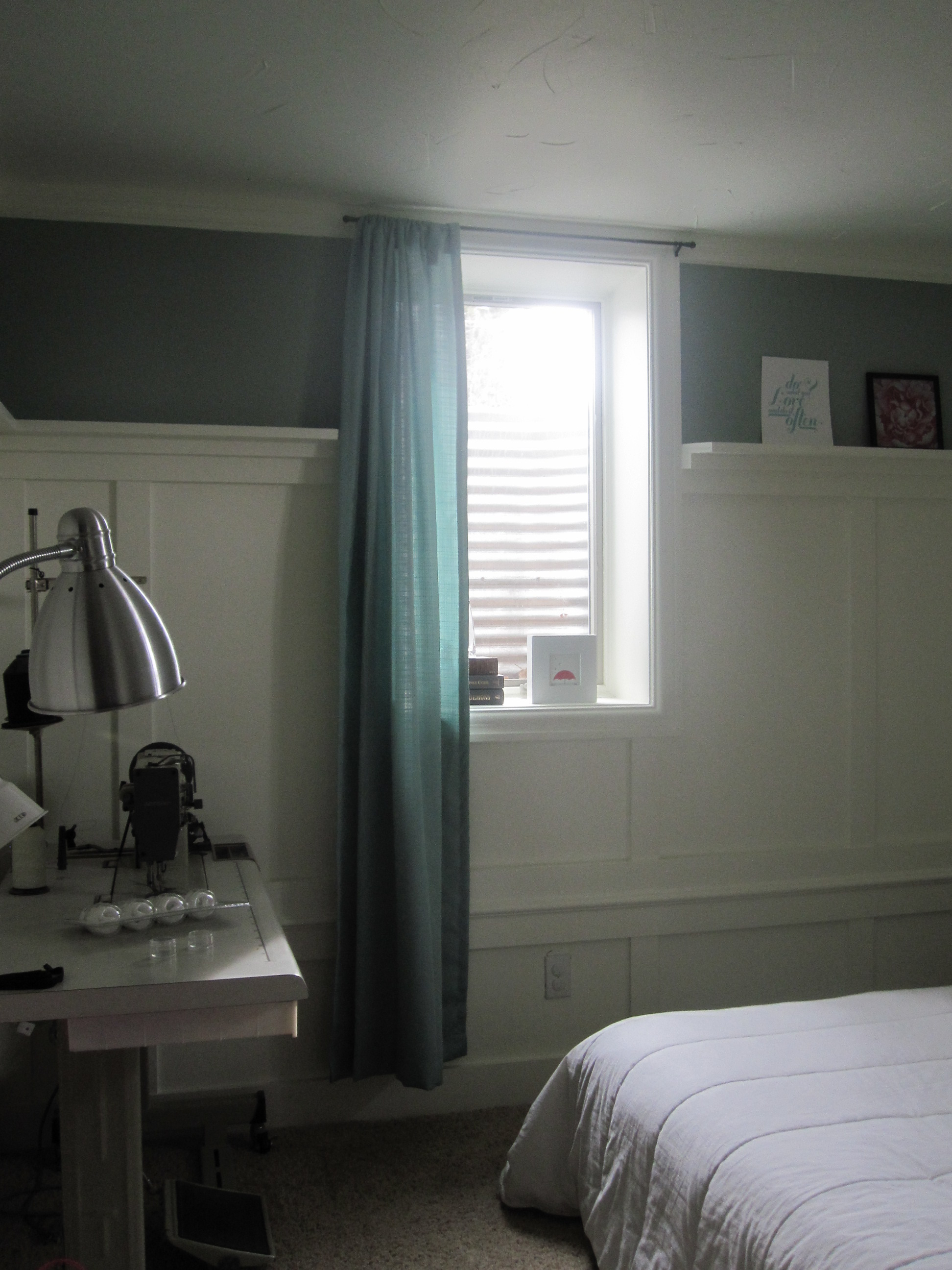 small basement bedroom curtains hung opposite