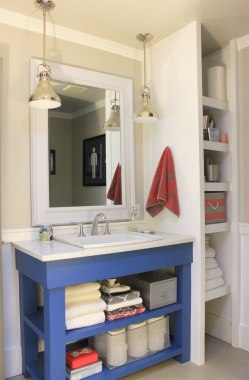 Give a bathroom color with bright accessories: https://ourhumbleabodeblog.com/2012/06/18/the-chicago-blues/