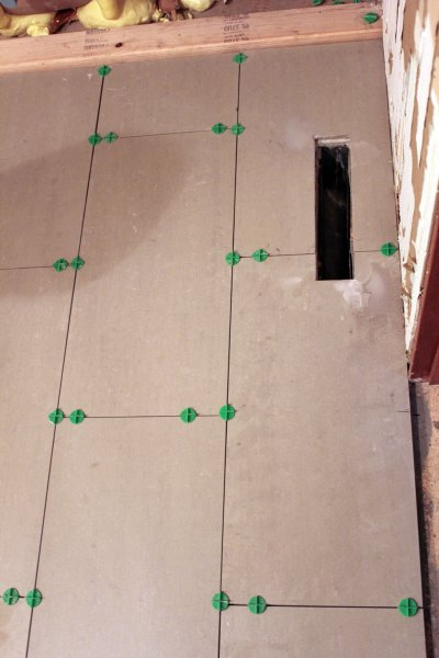 how to cut toilet hole in tile