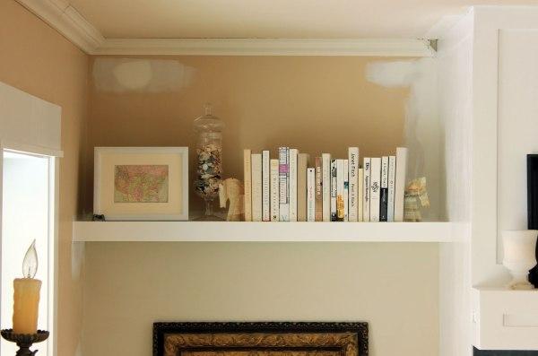 Family-Room-Bookshelf-Arrangement-Books-and-White-Frame-Close