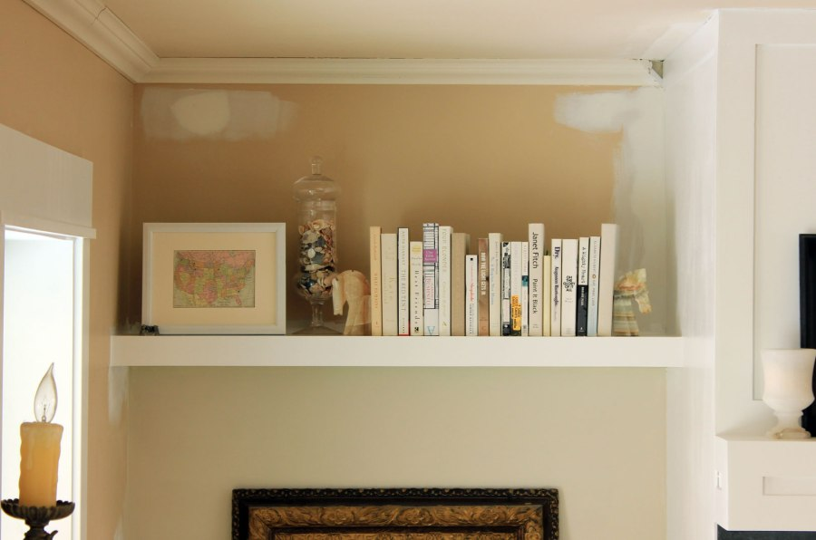 Family-Room-Bookshelf-Arrangement-Books-and-White-Frame-Close