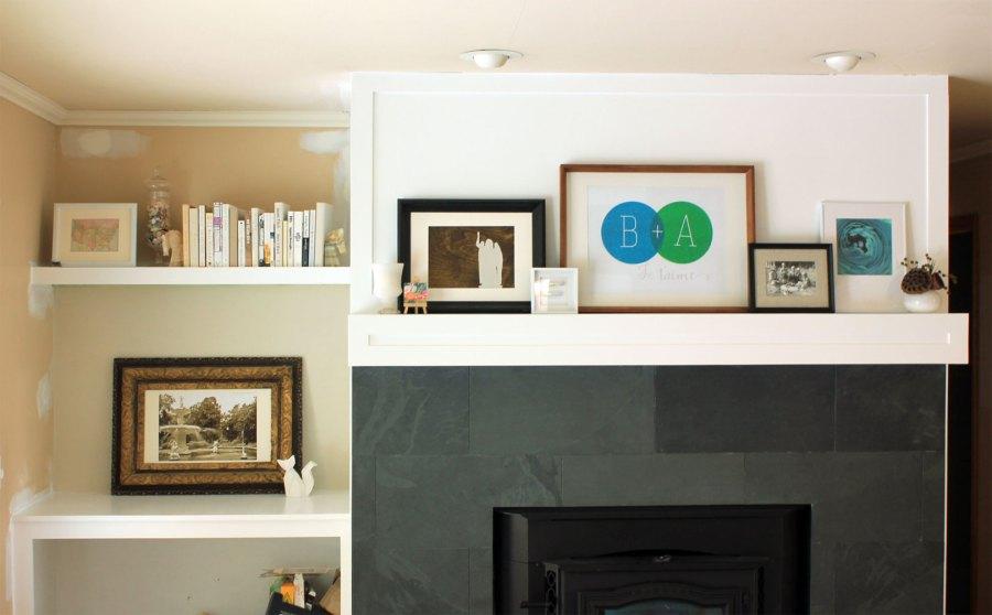 Family-Room-Bookshelf-Arrangement-Books-and-White-Frame