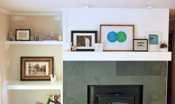 Family-Room-Bookshelf-Arrangement-Jars-with-Mantel-Simple