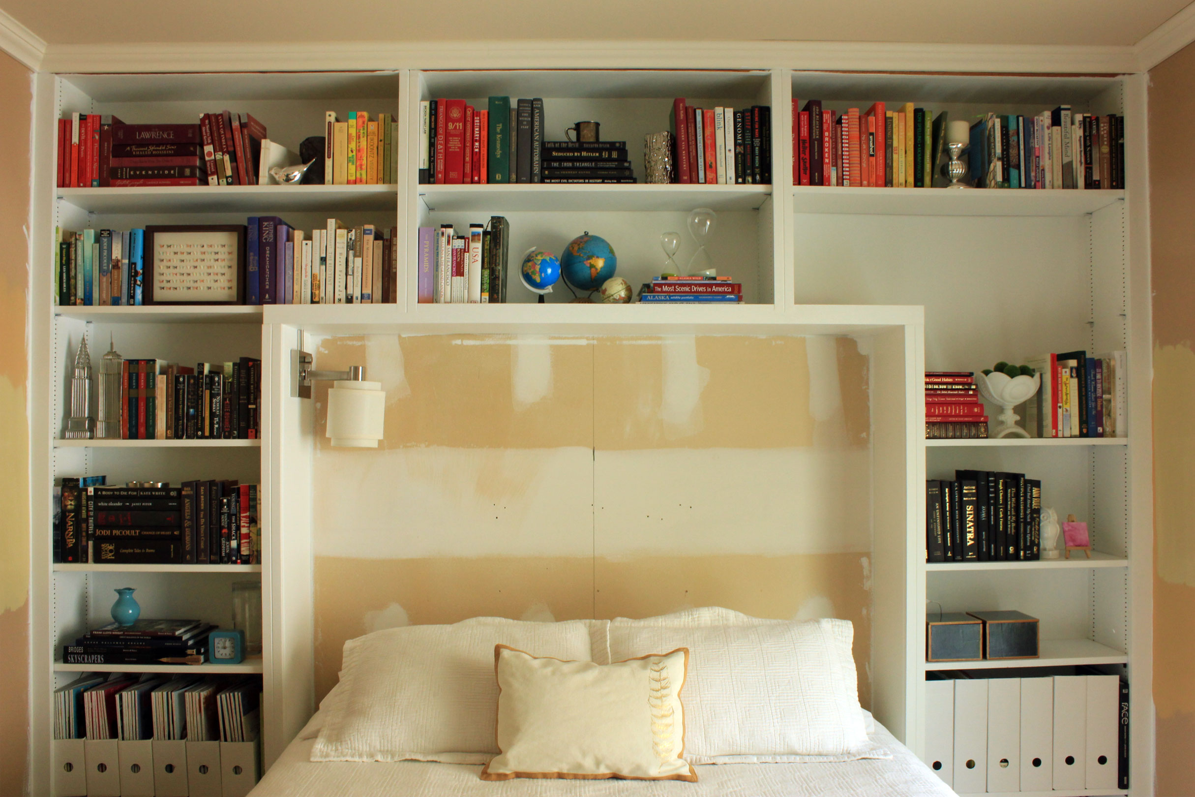 guest bedroom books on shelves