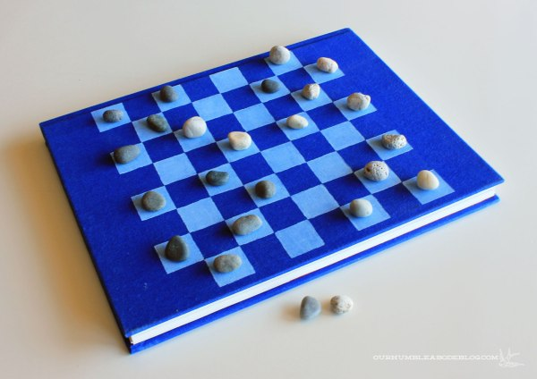 Book-for-Checker-Board-Playing-with-Rock-Pieces