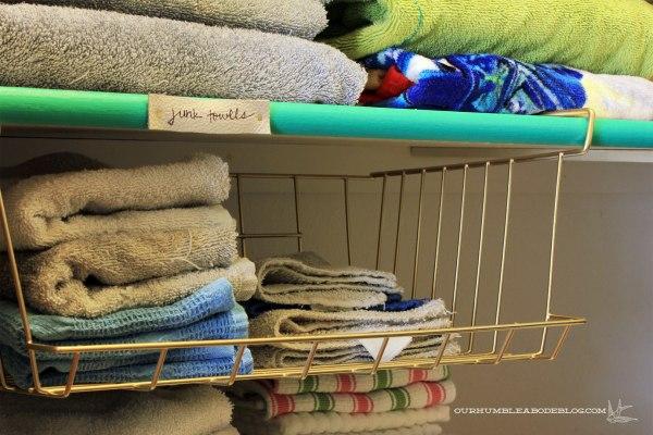 Linen-Closet-Organized-Junk-Towel-Bin