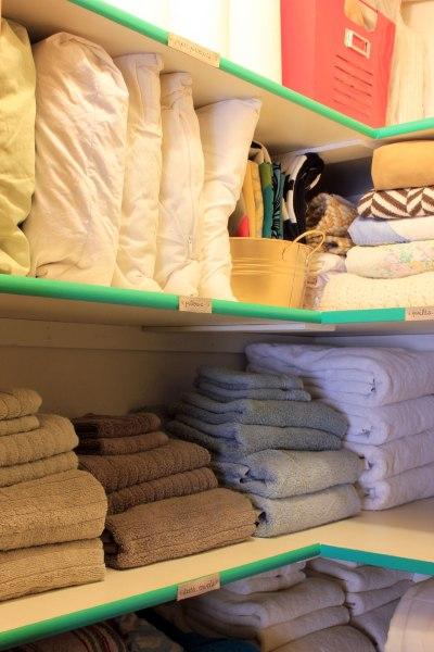 Linen-Closet-Organized-with-Emerald-Shelf-Front