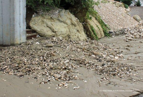 Saturday-Rain-Storm-Mud-and-Rock-in-Road