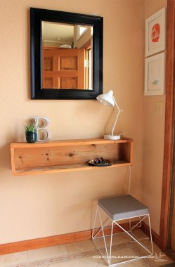 Add a box style shelf to an entry: https://ourhumbleabodeblog.com/2013/11/14/console-ation-prize/