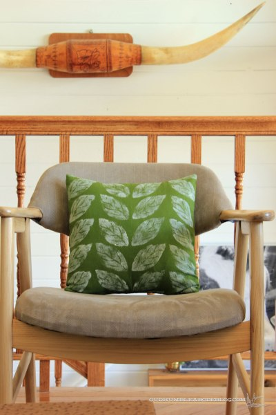 Green-Leaf-Pillow-on-Chair