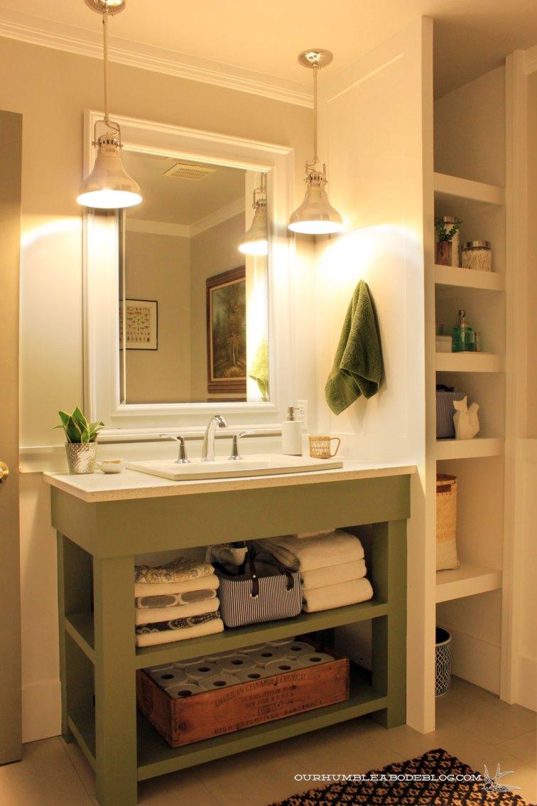 Use bold paint on a bathroom vanity: https://ourhumbleabodeblog.com/2014/06/16/olive-you/