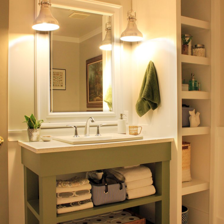 Use bold paint on a bathroom vanity: https://ourhumbleabodeblog.com/2014/06/16/olive-you/