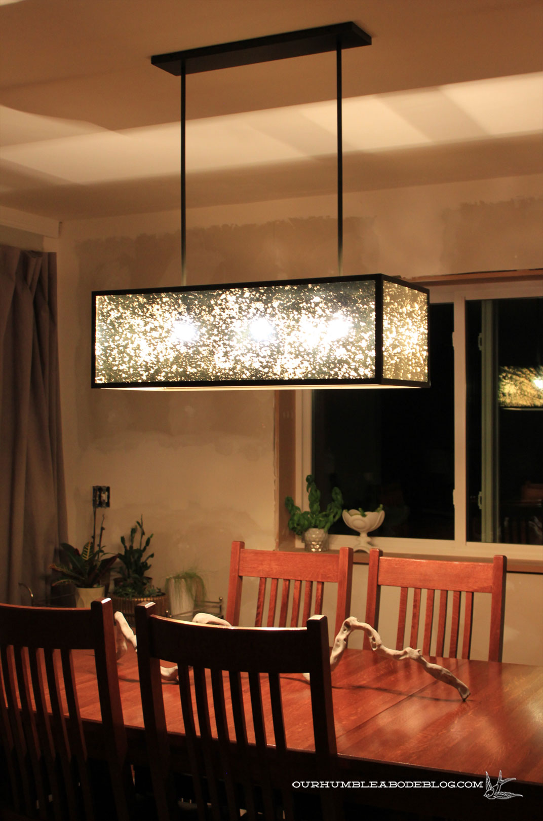 West elm panorama chandelier on at night vertical arubaitofo Choice Image
