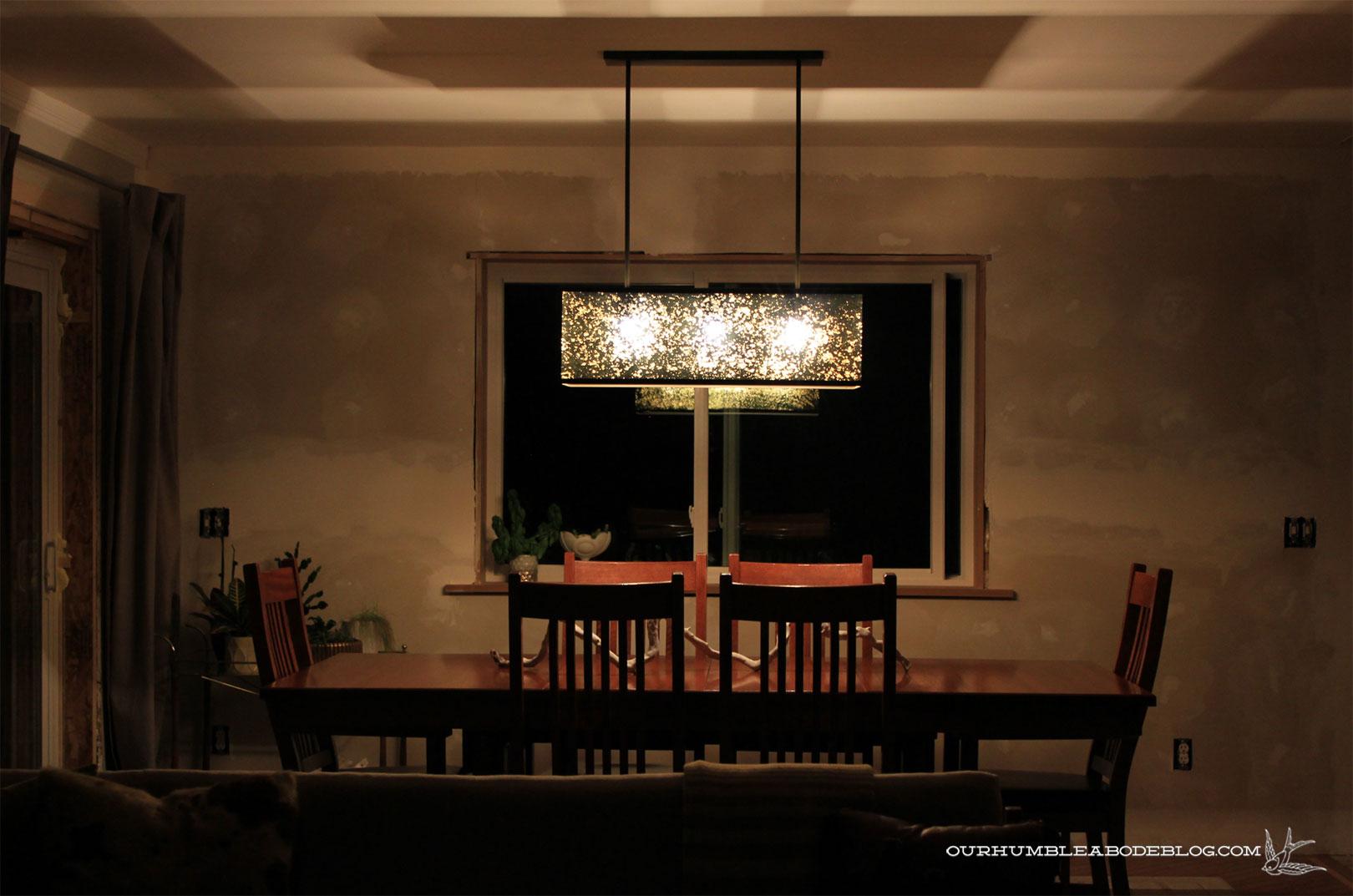 West elm panorama chandelier on at night arubaitofo Choice Image