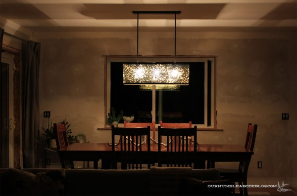 West-Elm-Panorama-Chandelier-on-at-Night