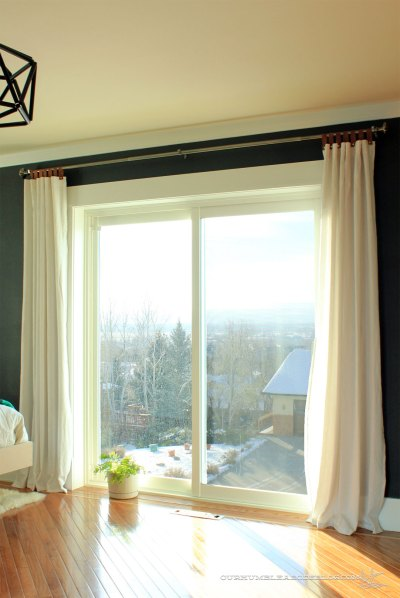 Leather-Tab-Top-Curtains-in-Master-Bedroom