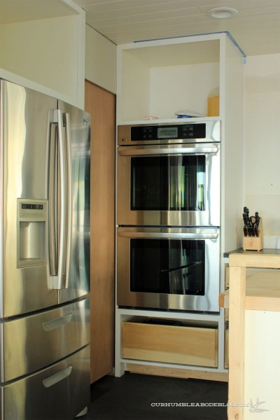 Unfinished-Pantry-Door-Closed-Toward-Ovens