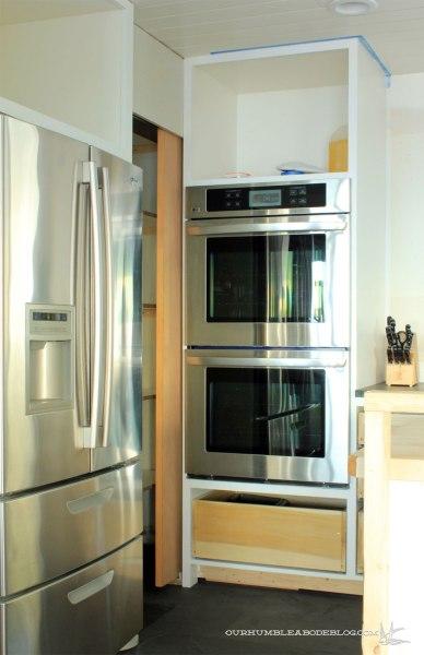 Unfinished-Pantry-Door-Open-Toward-Ovens