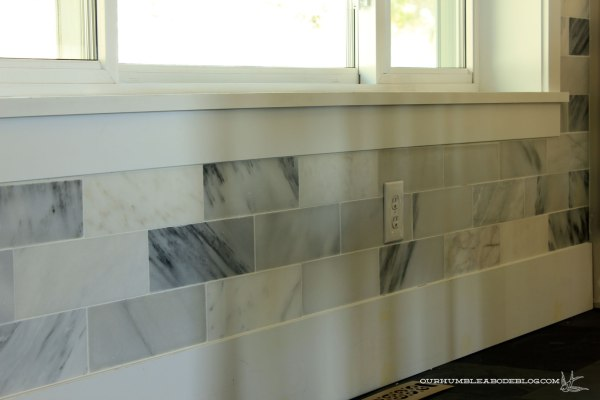 Marble-Backsplash-Under-Window