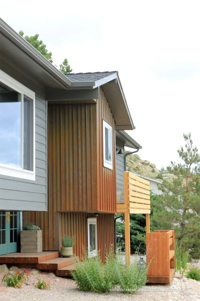 Front-of-House-Side-Angle-Rusted-Steel-Siding