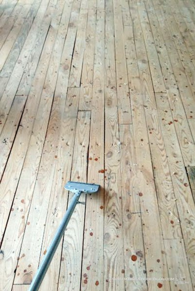 Scraping-Staples-from-Subfloors-in-Sitting-Dining-Room