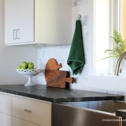 Long-Narrow-Cutting-Board-in-Kitchen-Toward-Ovens