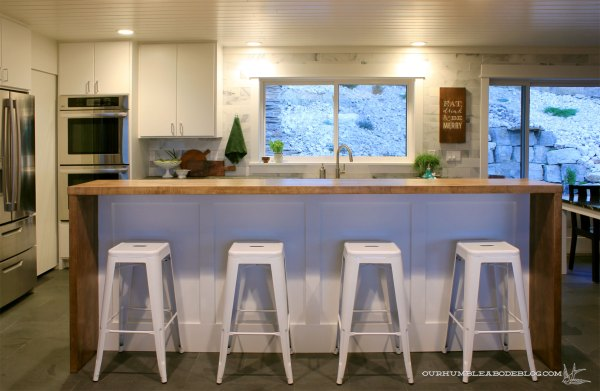 Kitchen-with-Lights-on-from-Dining