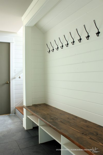 Build in a mini mudroom: https://ourhumbleabodeblog.com/2016/04/01/mud-nook/