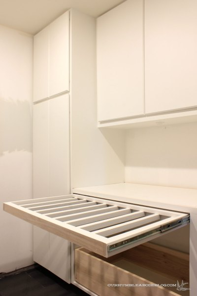 Basement-Laundry-Room-Pull-Out-Drying-Rack