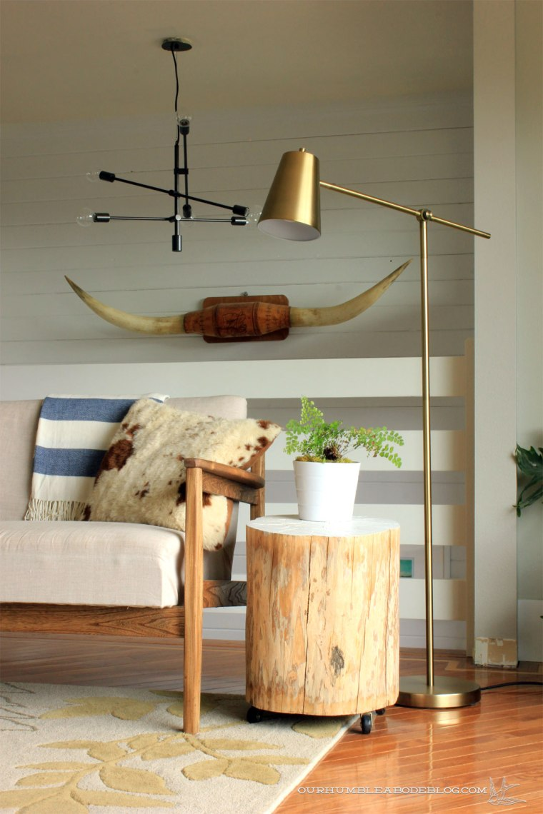 brass-floor-lamp-by-wood-sofa