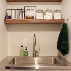 stainless-steel-counters-at-laundry-room-sink