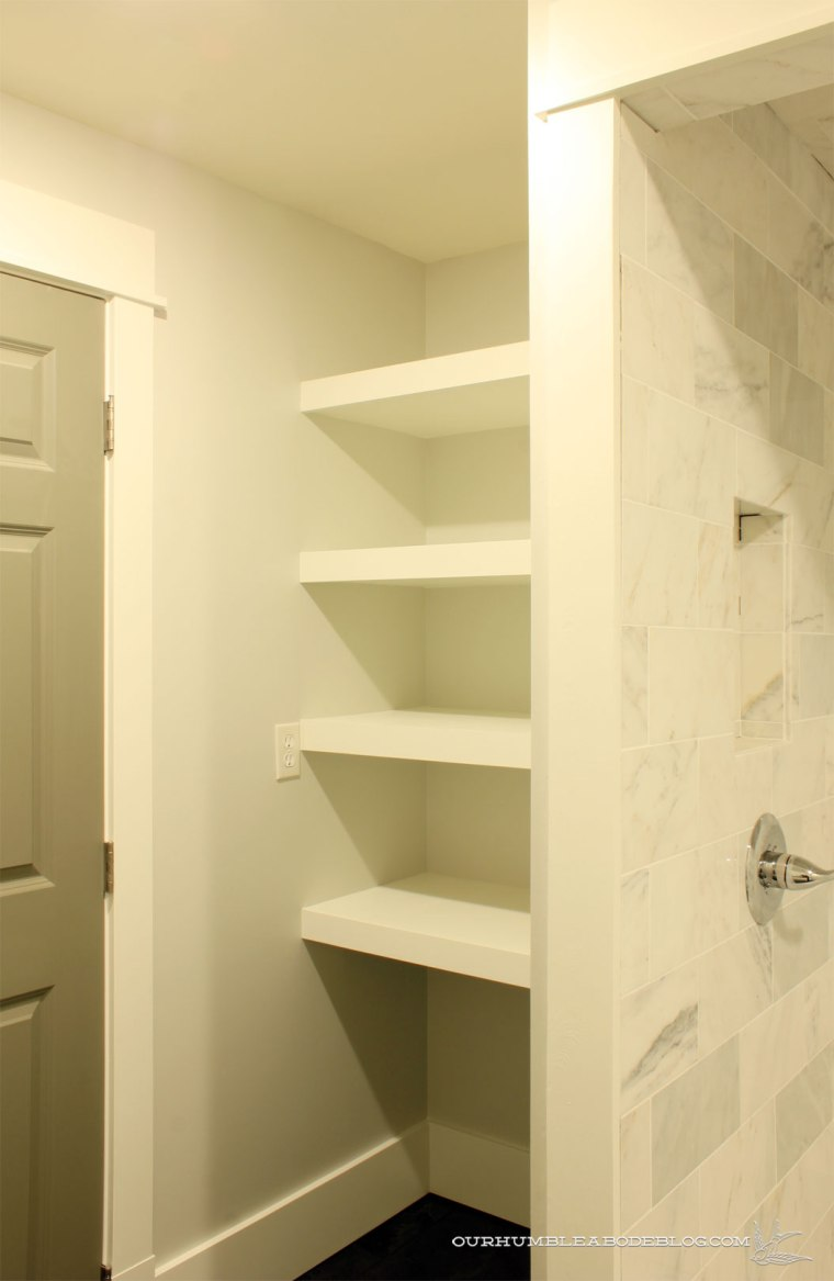 baement-bathroom-shelves-behind-door