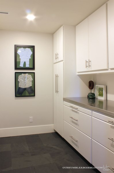 basement-art-baby-clothes-in-laundry-room