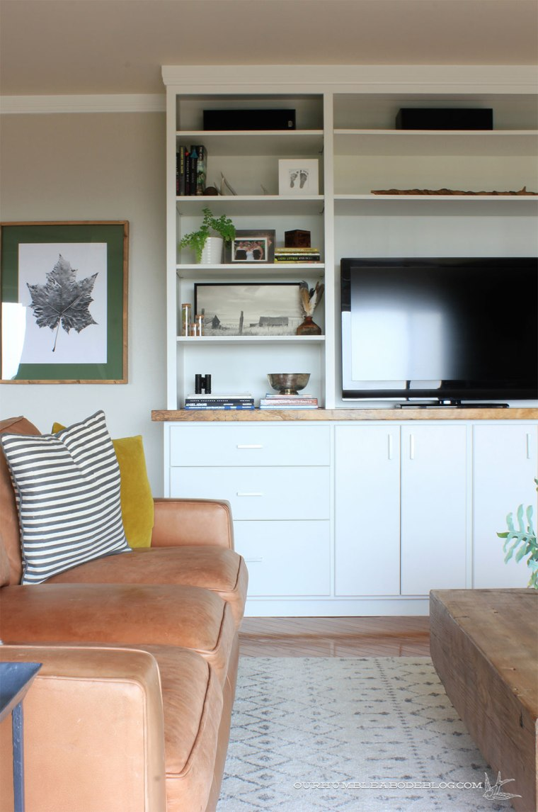 Complete-Entertainment-Center-Styled-with-Leather-Sofa