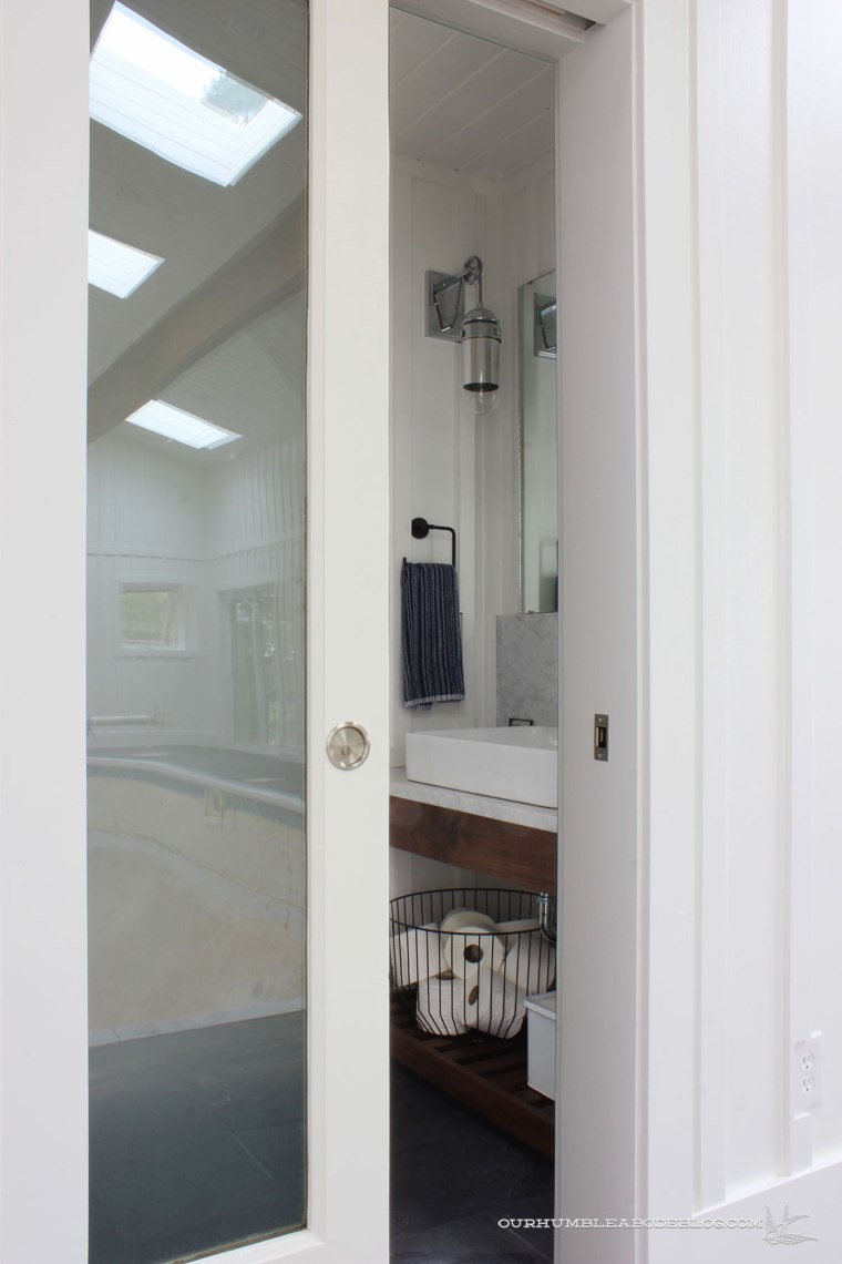 Pool-House-Finished-Bathroom-Overall-Pocket-Door