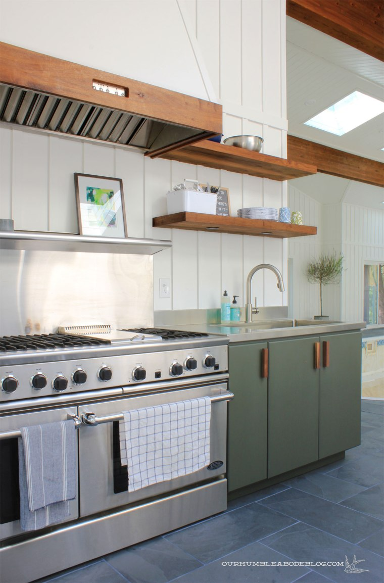 Pool-House-Green-Kitchen-Cabinets-with-Walnut-Handles-from-Back-Door