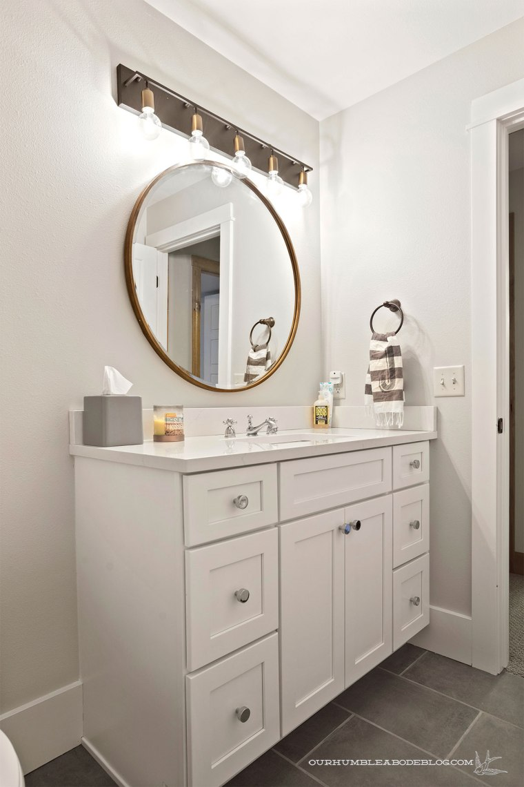 Basement-Round-Mirror-Bathroom-Vertical