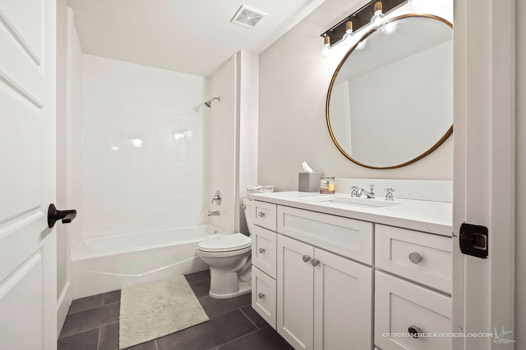 Basement-Round-Mirror-Bathroom
